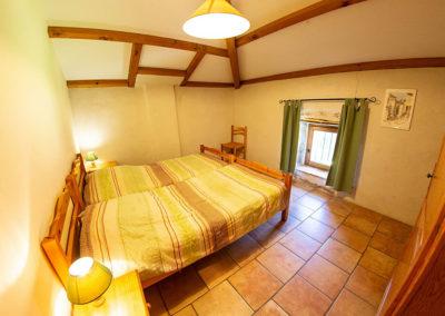 Une chambre du gîte Le Palmier au Domaine de l'Astic en Ardèche